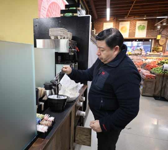 Barista Charlie Yanez makes a pot of coffee in the New Rochelle Farms supermarket on North Avenue and Lincoln Avenue in New Rochelle, Jan. 17, 2019.