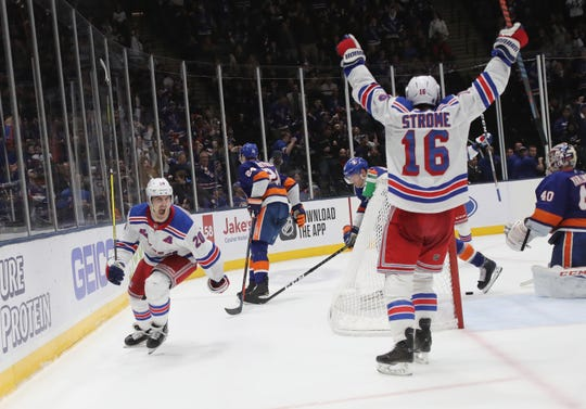 Chris Kreider #20 of the New York Rangers scores the game winning goal on the power-play at 19:35 of the third period against the New York Islanders at NYCB Live's Nassau Coliseum on January 16, 2020 in Uniondale, New York. The Rangers defeated the Islanders 3-2.