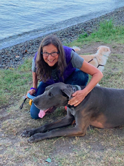Elizabeth Braverman with her dogs: Mouse is in the front and Pearl is in the back. Braverman is trying to sort through a memory from her childhood of finding a little girl's body in the woods of Stony Point.