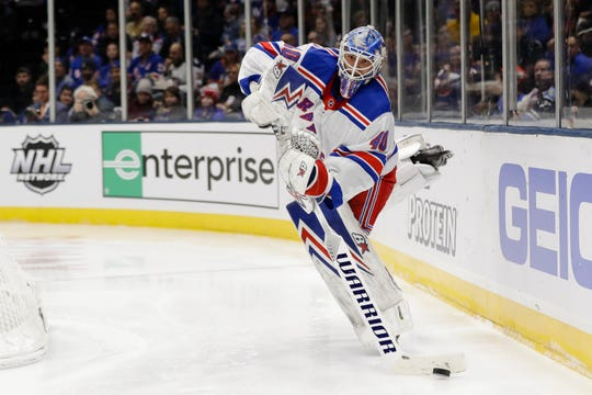 New York Rangers goaltender Alexandar Georgiev (40) passes to a teammate during the second period of an NHL hockey game against the New York Islanders Thursday, Jan. 16, 2020, in Uniondale, N.Y.