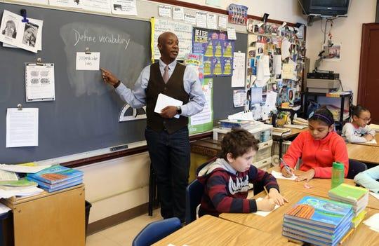 Bryan Boyd, a 4th grade teacher at the Paideia School 24 in Yonkers, teaches a math lesson at the school, Jan. 17, 2020.