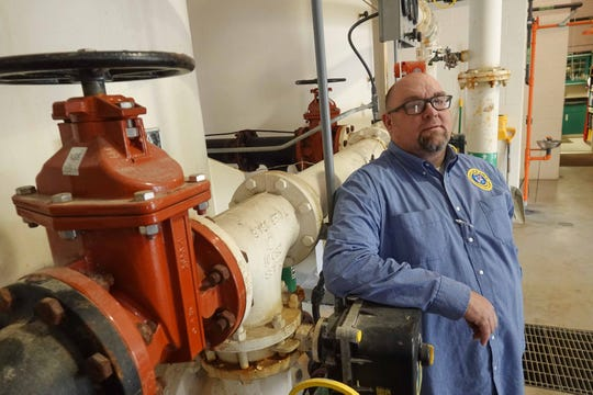 Brandon Slater, a water and maintenance supervisor for the Town Blades, stands inside water treatment plant that filters water to local residents.