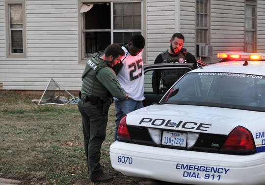 Wichita Falls police arrest a possible suspect after conducting a SWAT search warrant on Hines Blvd, Wednesday.
