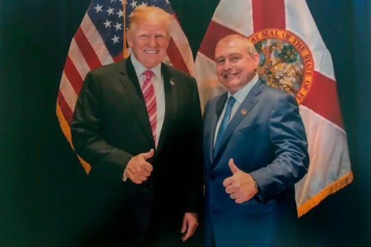 This undated image released by the House Judiciary Committee from documents provided by Lev Parnas to the committee in the impeachment probe against President Donald Trump, shows a photo of Lev Parnas with Trump in Florida. Parnas, a close associate of Trump's personal lawyer Rudy Giuliani is claiming Trump was directly involved in the effort to pressure Ukraine to investigate Democratic rival Joe Biden. Trump on Thursday, Jan. 16, 2020, repeated denials that he is acquainted with Parnas, despite numerous photos that have emerged of the two men together. (House Judiciary Committee via AP) ORG XMIT: WX110