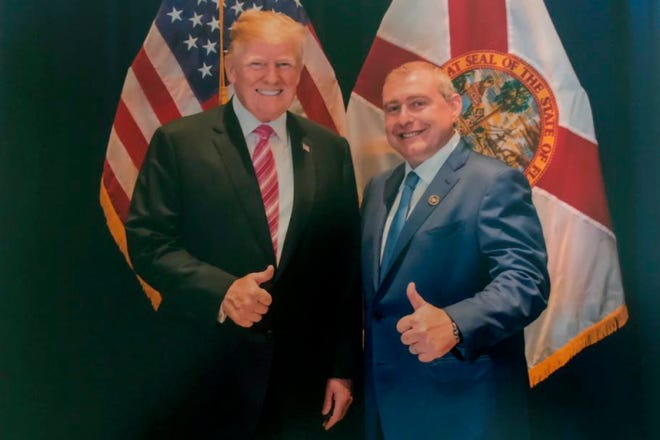 This undated image released by the House Judiciary Committee from documents provided by Lev Parnas to the committee in the impeachment probe against President Donald Trump, shows a photo of Lev Parnas with Trump in Florida.  (House Judiciary Committee via AP)
