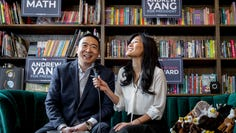 epa08073744 Democratic Presidential Candidate Andrew Yang (L) and his wife Evelyn Yang (R) speak to voters at an event in Iowa City, Iowa, USA, 14 December 2019 (issued 15 December 2019). The businessman became the seventh and final candidate to make the Democratic Presidential Debate on December 19.  EPA-EFE/GARY HE ORG XMIT: MCX012
