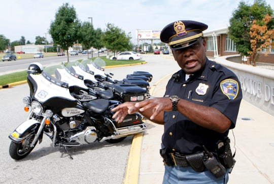 FILE - In this July 14, 2011, file photo, South Bend Police Chief Darryl Boykins discusses the four new Harley Davidson Electra Glide motorcycles for the department in South Bend, Ind.. When Pete Buttigieg got rid of South Bend's black police chief Darryl Boykins, it set off a flurry of anger in the Indiana city. Eight years later, the move still shadows his presidential campaign, giving rise to complaints he has a blind spot on race and raising questions about whether he can attract the support of African Americans who are crucial to earning the Democratic nomination. (Greg Swiercz/South Bend Tribune via AP)
