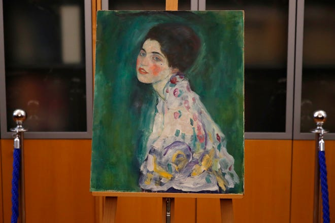 The painting which was found last December near an art gallery and believed to be the missing Gustav Klimt's painting 'Portrait of a Lady' is displayed during a press conference in Piacenza, Italy, Friday, Jan. 17, 2020.