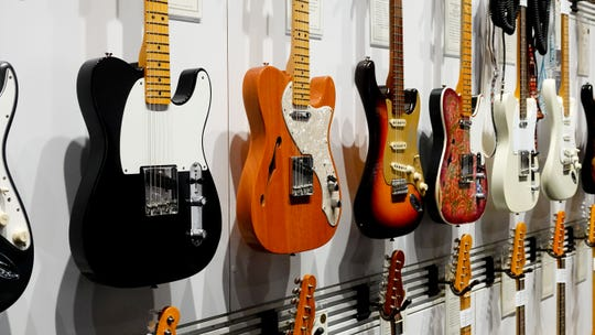 Fender guitars on the wall at NAMM