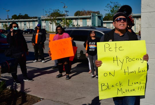 Protestors with Black Lives Matter protest a visit by Democratic presidential candidate and former South Bend, Ind., Mayor Pete Buttigieg, during a visit to A Bridge Home Project homeless shelter in Los Angeles on Friday, Jan. 10, 2020.