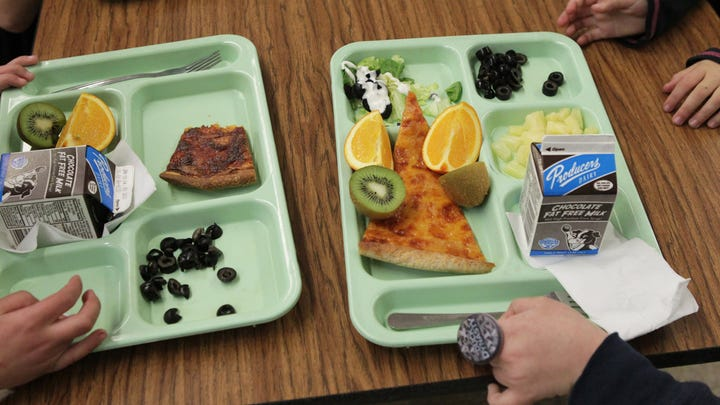 Students at Bella Vista School in Bella Vista, Calif., eat lunch on Friday, Jan. 10, 2014. They had a choice of homemade pizza or pasta. (AP Photo/ The Record Searchlight, Andreas Fuhrmann) ORG XMIT: CARED104
