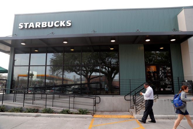 Customers come and go at a Starbucks on South Claiborne Ave. in New Orleans, Thursday, Jan. 16, 2020. Starbucks, the home of the $4 latte, is expanding a program to open coffee shops in poor neighborhoods.