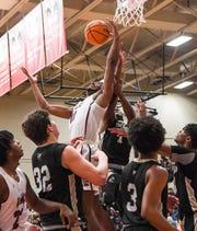 Westside senior CJ Plantin rebounds near T.L. Hanna senior John Haddock Rogers during the first quarter at Westside High School in Anderson on Friday.