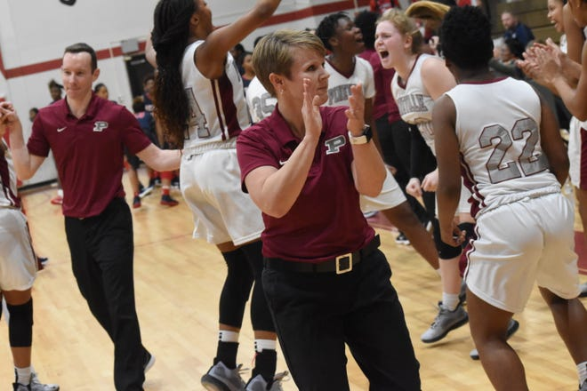 Pineville coach Tiffany Edmondson celebrates with her team after defeating West Monroe 64-59 in overtime Friday, Jan. 17, 2019 in a home conference game.