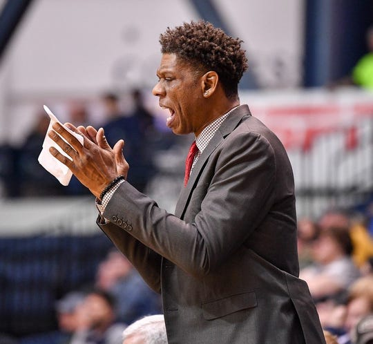 Monmouth assistant coach J.R. Reid shouts encouragement from the bench during the Hawks' victory over Marist at OceanFirst Bank Center in West Long Branch on Jan. 16, 2020.
