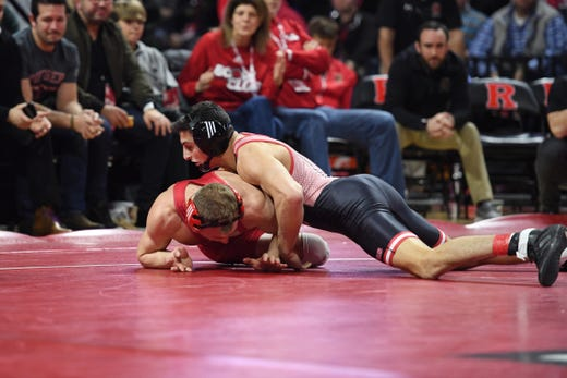 Cornell wrestling at Rutgers on Friday, January 17, 2020. (Right) Gerard Angelo, of Rutgers, and Hunter Richard, of Cornell, in their 149 pound match.