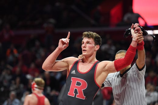 Cornell wrestling at Rutgers on Friday, January 17, 2020. Jordan Pagano, of Rutgers, celebrates after defeating Jonathan Fagen, of Cornell, in their 197 pound match.