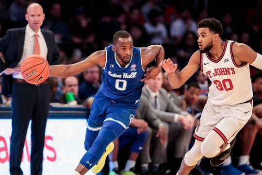 Seton Hall Pirates guard Quincy McKnight (0) drives to the basket as St. John's Red Storm guard LJ Figueroa (30) defends