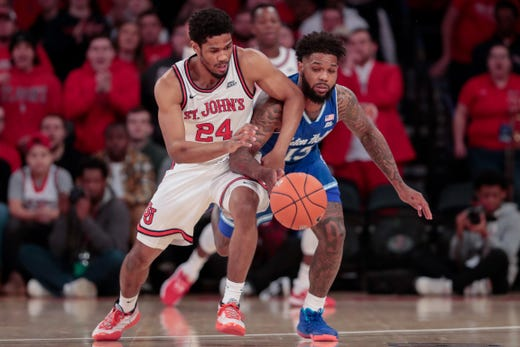 Seton Hall Pirates guard Myles Powell (13) fights for the ball against St. John's Red Storm guard Nick Rutherford (24) during the first half at Madison Square Garden.