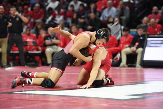 Cornell wrestling at Rutgers on Friday, January 17, 2020. (Left) Michael Vanschenkbrill, of Rutgers, and Adam Santoro, of Cornell, in their 157 pound match.