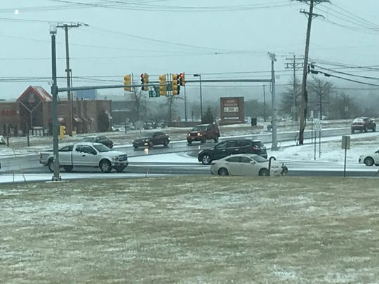 Snow falling on Route 66 and Jumping Brook Road in Neptune