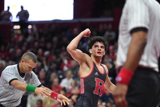Cornell wrestling at Rutgers on Friday, January 17, 2020. Nic Aguilar, of Rutgers, celebrates winning his 125 pound match.