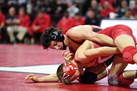 Cornell wrestling at Rutgers on Friday, January 17, 2020. Nic Aguilar, of Rutgers on his way to winning his 125 pound match against Dominic LaJoie, of Cornell.