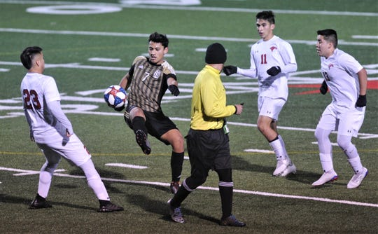 Abilene High's Joseph Martinez (7) kicks the ball as Cooper's Isaiah Arratia (23), Trey Castillo (11) and Chico Lopez (13) defend. The Eagles beat Cooper 3-1 in the nondistrict game Friday, Jan. 17, 2020, at Shotwell Stadium.