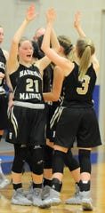Haskell players Calie Everett (21) and Landry Hanson (3) celebrate after a game against Stamford on Jan. 17.