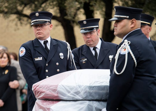 The Lubbock Fire and Rescue honor guard carries Lubbock Fire and Rescue Lt. Eric Hill's casket out of Rip Griffin Center on Friday, Jan. 17, 2020, in Lubbock, Texas.