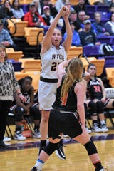 Wylie's Makinlee Bacon (25) follows through on a 3-point shot against Aledo on Friday. Bacon knocked down a 3 and hit a pair of key free throws in the fourth quarter of the 35-31 victory.