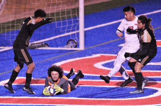 Abilene High goalie Dylan Luevanos, center, makes a stop in front of Cooper's Isiah Arratia and two Eagle defenders. The Eagles beat Cooper 3-1 in the nondistrict game Friday, Jan. 17, 2020, at Shotwell Stadium.