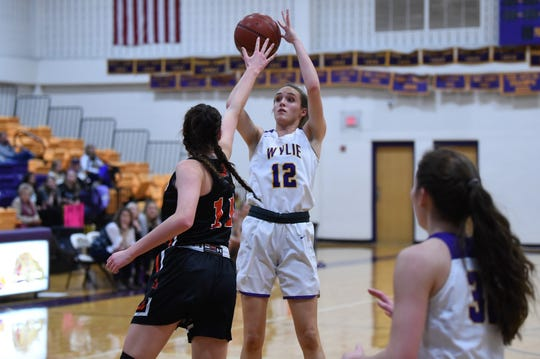 Wylie's Karis Christian (12) takes a shot against Aledo at Bulldog Gym on Friday. Christian finished with six points in the 35-31 win.