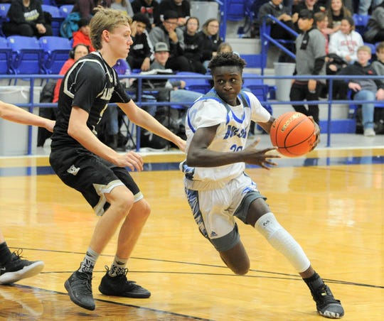 Stamford guard Stephon Johnson drives the ball against Haskell on Friday, Jan. 17, 2020, at Stamford High School.