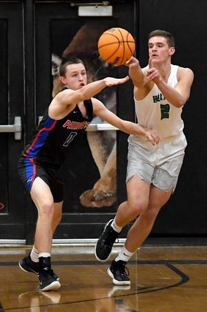 Mountain Heritage's Logan Higgins (2) passes the ball during a game against Madison last season. Photo by ANGELI WRIGHT/ ASHEVILLE CITIZEN-TIMES.