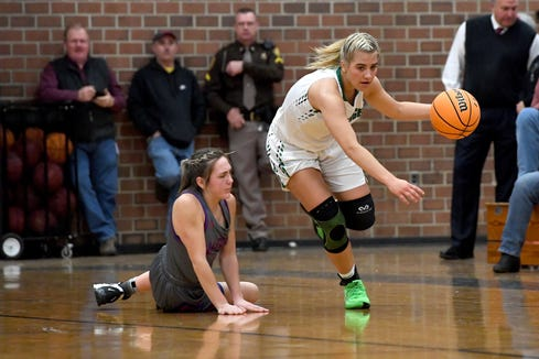 Mountain Heritage's 	Hannah Tipton steals the ball from Madison's Nakaila Marler during their game in Burnsville on Jan. 17, 2020.