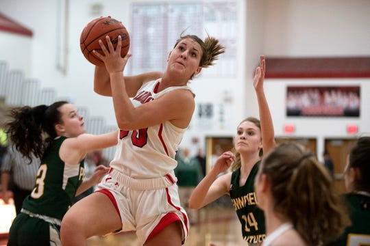 Coldwater senior Carlee Crabtree (30) grabs the rebound on Friday, Jan. 17, 2020 at Coldwater High School in Coldwater, Mich. Coldwater defeated Pennfield 69-37.