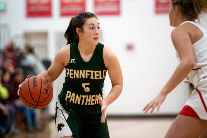 Pennfield junior Abigail Schwartz (5) passes the ball on Friday, Jan. 17, 2020 at Coldwater High School in Coldwater, Mich. Coldwater defeated Pennfield 69-37.