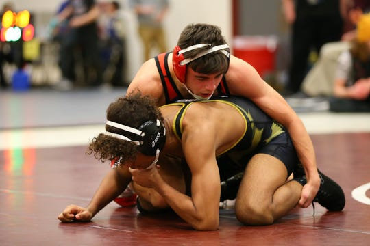 Chenango Forks' Logan Gumble, top, wrestles Corning's Charles Loucks in the 138-pound STAC final Friday at Johnson City. Gumble won, 14-1.