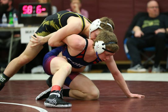 Corning's Chase Daudelin, top, ties up Chenango Forks' Cooper Rice in the 126-pound STAC final Friday at Johnson City. Daudelin won by pin.