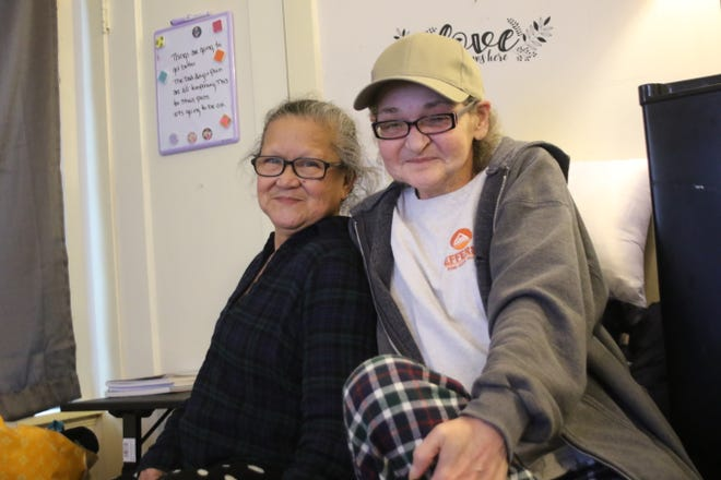 Self-described best-friends Patricia Wallace, 62, and Wendy Somerville, 54, inside their room at a shared living triplex. The pair, both homeless just a few months ago, live with 16 other women at a West Bremerton transitional home run by Eagle's Wings Coordinated Care.