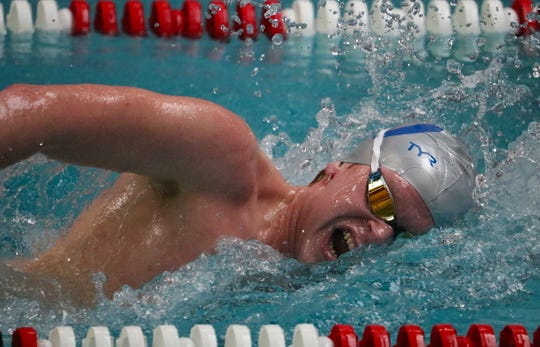 Olympic's Ryan Burchell took first in the 500-yard freestyle Saturday at the Swimvitational meet at Olympic Aquatic Center.