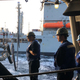 Sailors aboard the USS Nimitz monitor the cables and hoses between the ship and the Yukon, a Navy refueling ship less than 200 feet away.