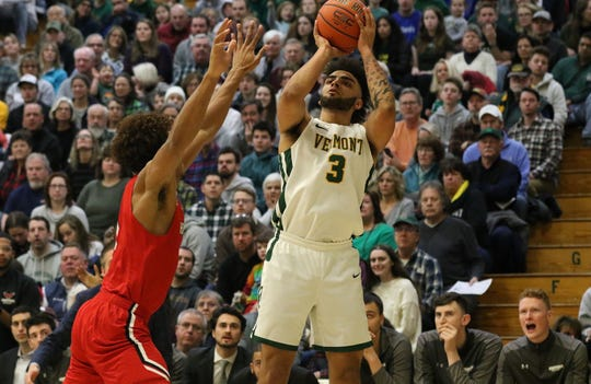 Anthony Lamb rises for a jumper in Vermont's 74-57 win over Hartford in America East men's basketball action at Patrick Gym on Saturday afternoon.