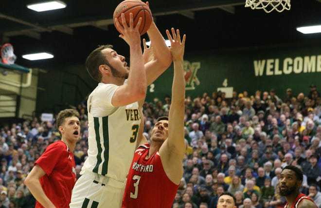 Ryan Davis goes for a layup in Vermont's 74-57 win over Hartford in America East men's basketball action at Patrick Gym on Saturday afternoon.