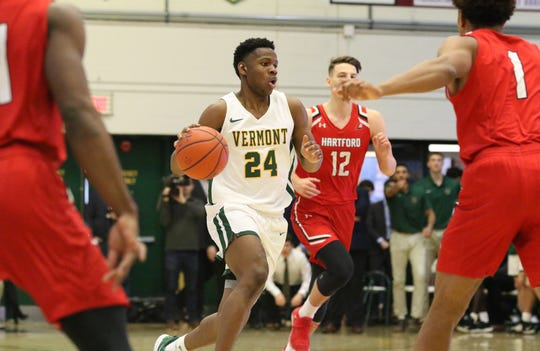 Ben Shungu looks to drive in Vermont's 74-57 win over Hartford in America East men's basketball action at Patrick Gym on Saturday afternoon.