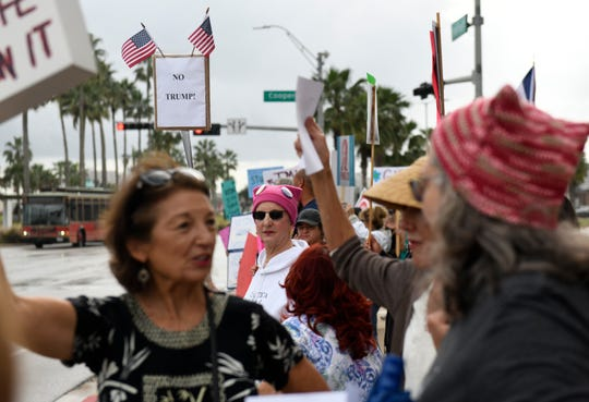 Various women hold signs during the Women's March, Saturday, Jan. 18, 2020, in Corpus Christi, Texas. The group held signs and chanted for an hour on Shoreline Blvd.