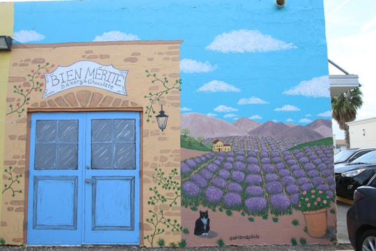 The Bien Merite mural features a lavender field, blue skies and hills on a French countryside. It is located near Bien Merite Bakery and Chocolate on Staples Street and Morgan Avenue
