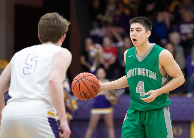 Huntington's Seth Beeler dribbles the ball against Unioto during a game  at Unioto High School on Jan. 17, 2020.