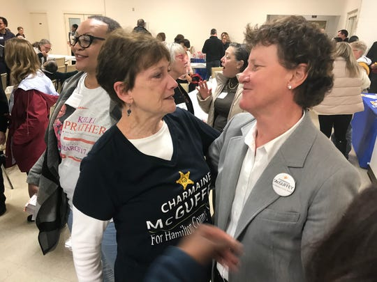 Charmaine McGuffey(Right) celebrates Saturday with her campaign manager, Mary Carol Melton, on getting the endorsement for sheriff from the Hamilton County Democratic Party